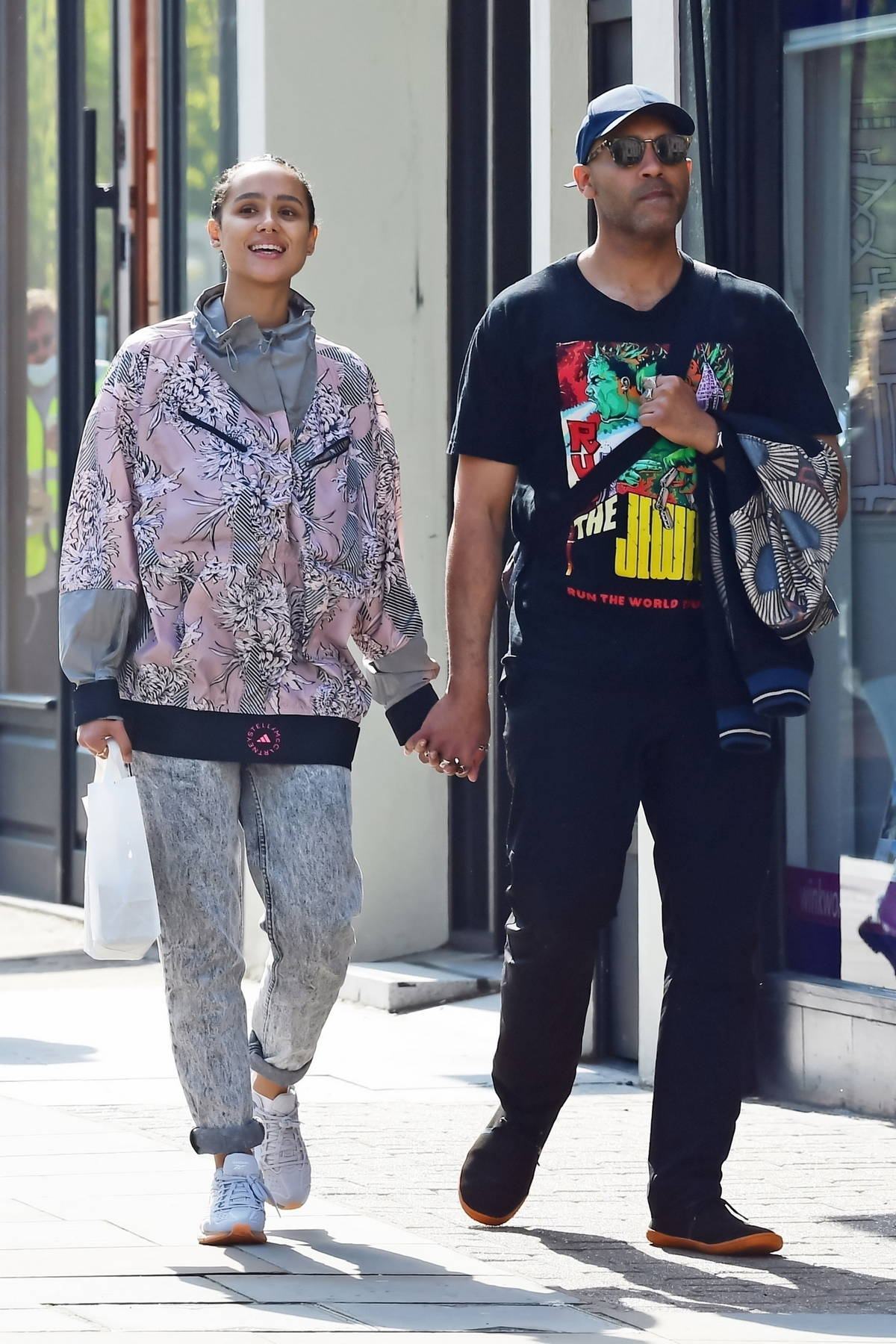 Nathalie Emmanuel and Alex Lanipekun walk hand-in-hand during a romantic stroll in Notting Hill, London, UK
