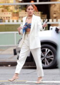 Olivia Culpo looks flawless in a colorful scarf top with a white suit while out for dinner in the West Village, New York