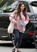 Olivia Munn goes casual in an oversized sweatshirt and leggings as she steps out in Los Angeles