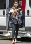 Olivia Munn steps out barefoot as she takes her dogs to a portable pet grooming van in Los Angeles