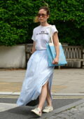 Olivia Wilde looks great in a white t-shirt and light blue summer skirt while out in North London, UK