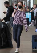 Olivia Wilde spotted in a striped top and skinny jeans as she touches down in Los Angeles