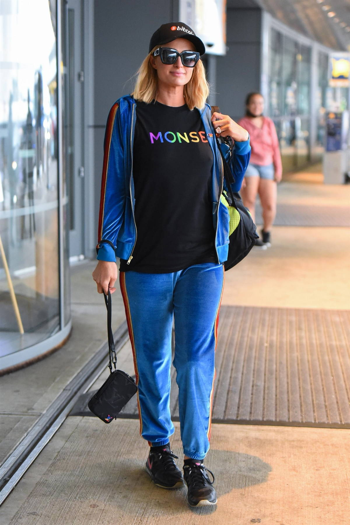 Paris Hilton keeps it casual chic in blue designer tracksuit as she arrives for a flight out of JFK Airport in New York City