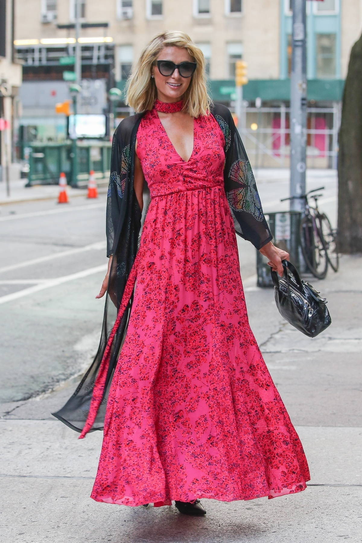 Paris Hilton looks glamorous in a floral print red dress as she strikes a few pose in New York City