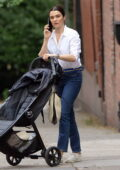 Rachel Weisz chats on her phone while stepping out with an empty pram in Brooklyn, New York