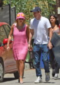 Rita Ora seen wearing a pink Prada dress matching Taika's tank tee as she leaves his place during his workout session, Los Angeles
