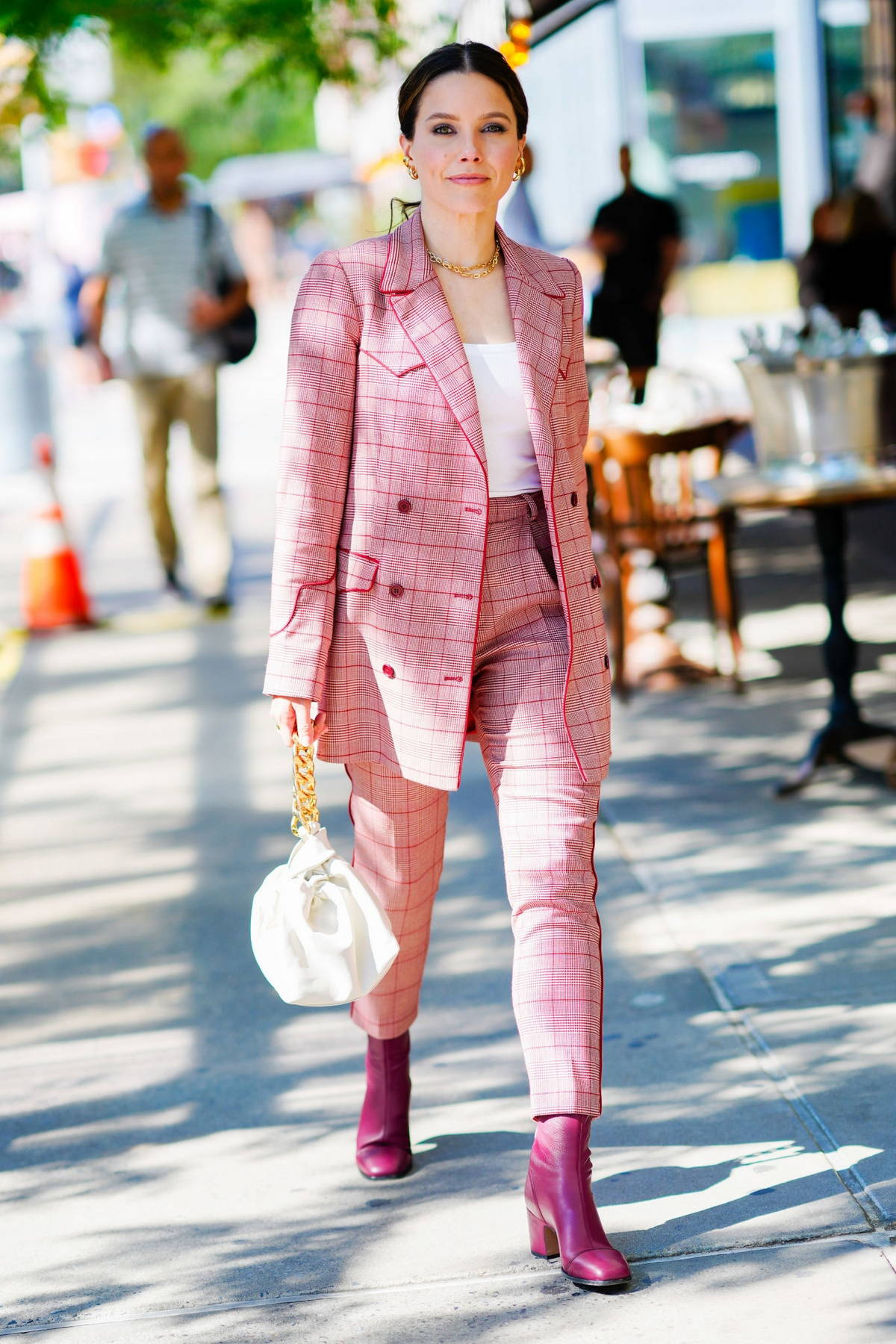 Sophia Bush looks stylish in a pink plaid suit with matching boots while stepping out in New York City
