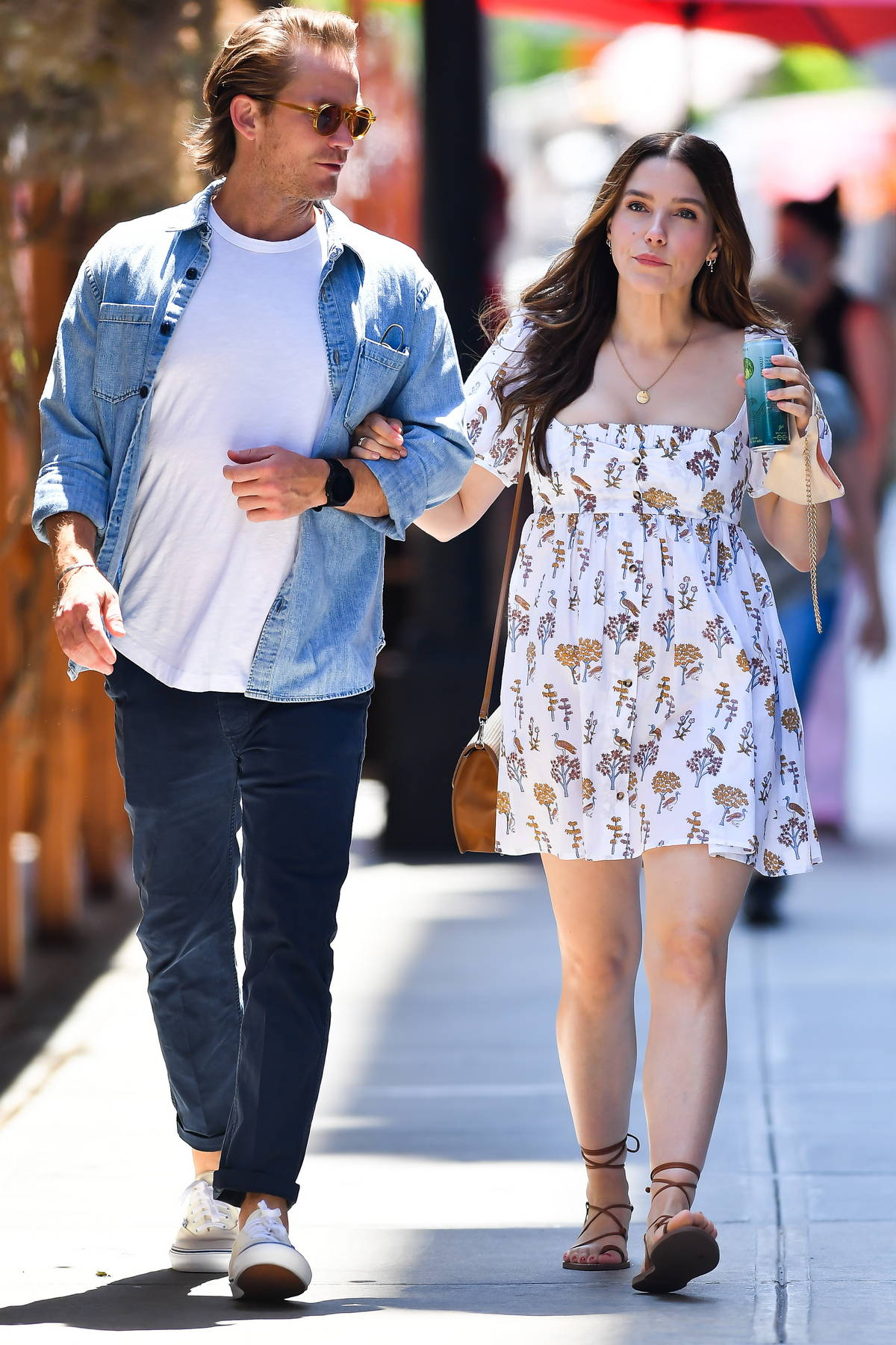 Sophia Bush shows her summer style in a floral print dress while heading out for lunch with Grant Hughes in New York City