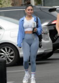 Vanessa Hudgens shows off her toned figure in a white crop top and light blue leggings as she heads to a gym in Los Angeles