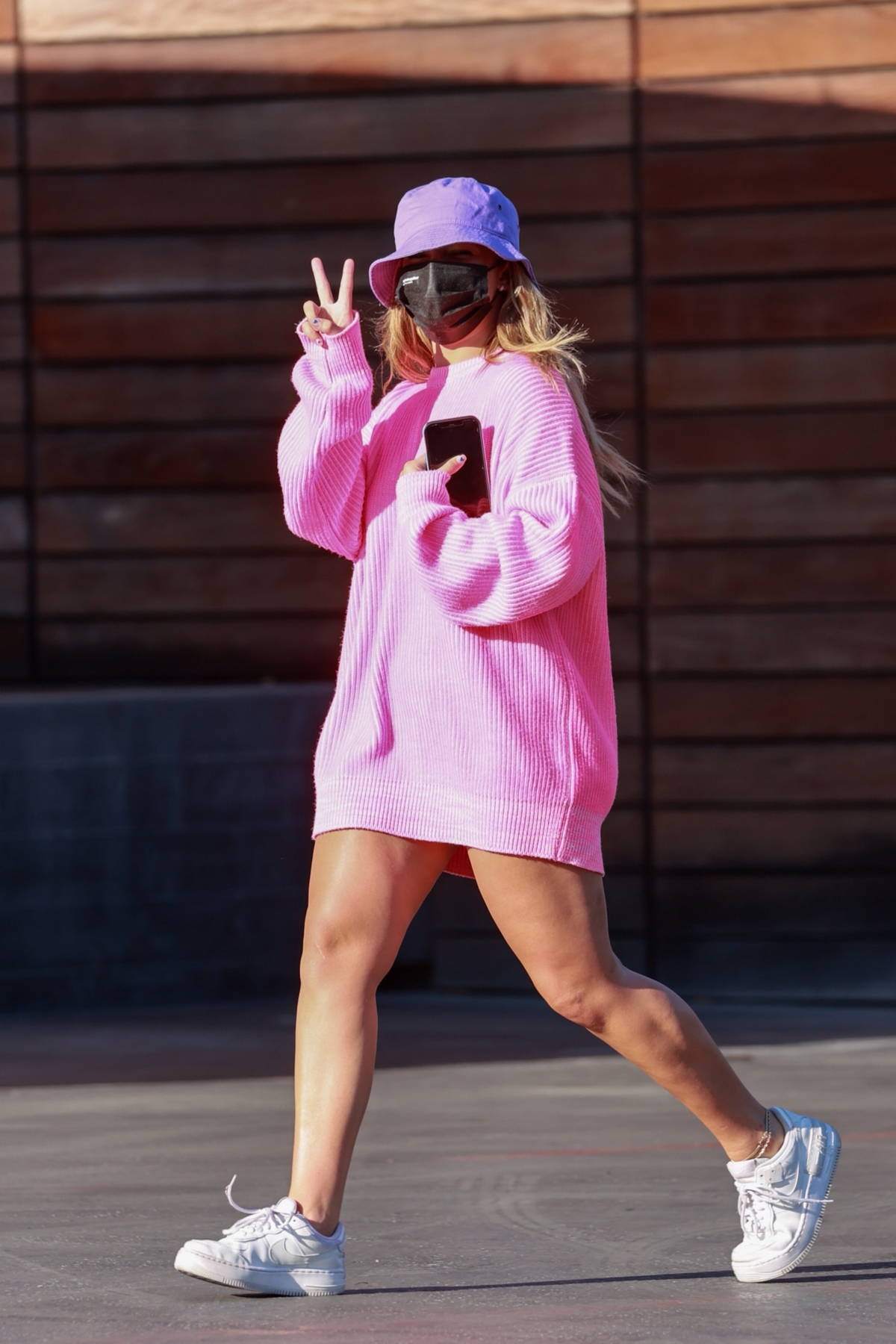 Addison Rae looks pretty in pink oversized sweater while shopping at Maxfield's in West Hollywood, California