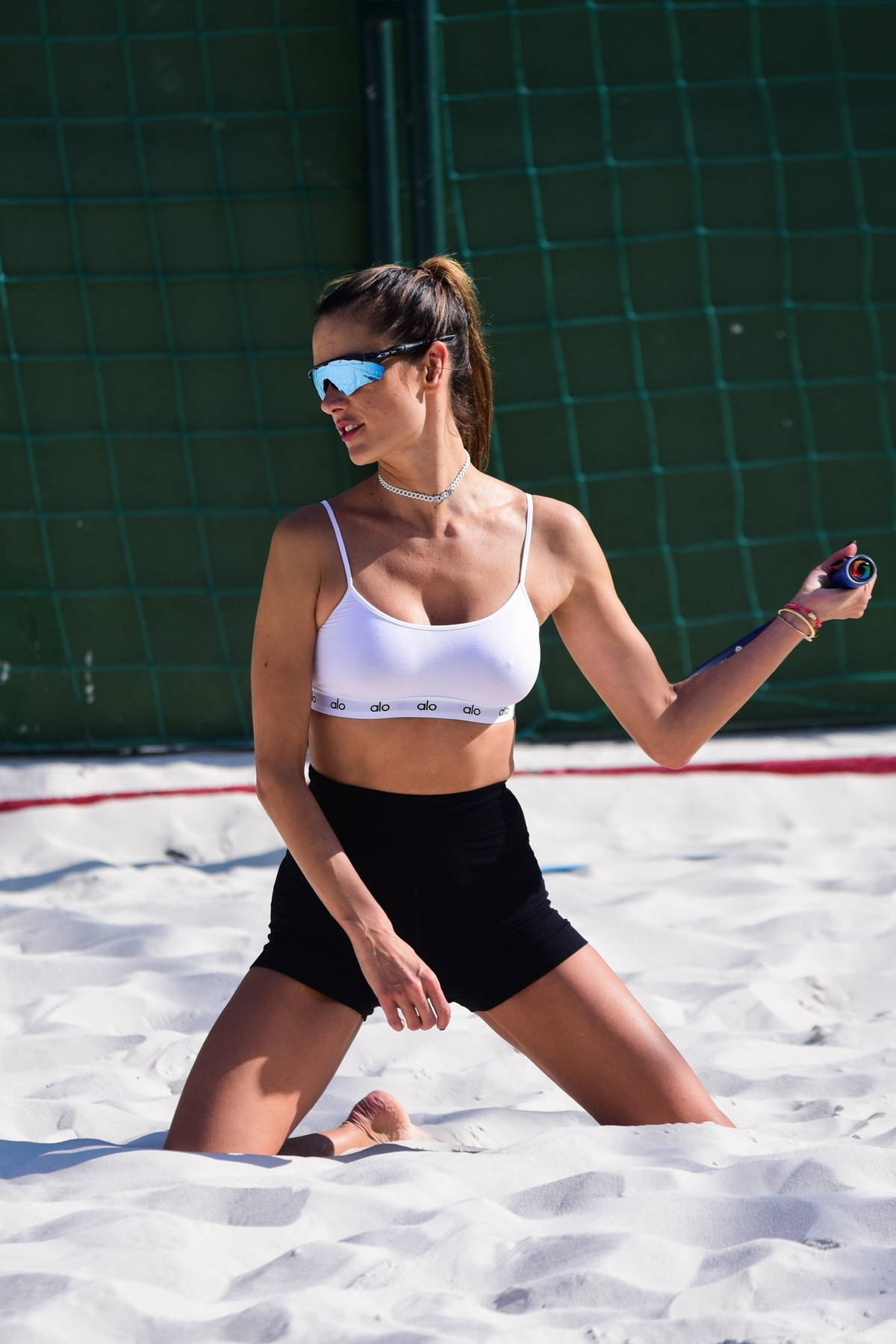 Alessandra Ambrosio displays her toned abs while while playing beach tennis with a friend in Sao Paulo, Brazil