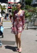 Bella Hadid looks radiant in a colorful sheer dress while out during the 74th Cannes Film Festival in Cannes, France
