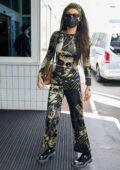 Bella Hadid looks trendy in skintight Jean Paul Gaultier co-ord while arriving at Le Bourget Airport in Paris, France