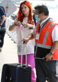Bella Thorne opts for a makeup free casual look as she arrives to catch a flight out of LAX in Los Angeles