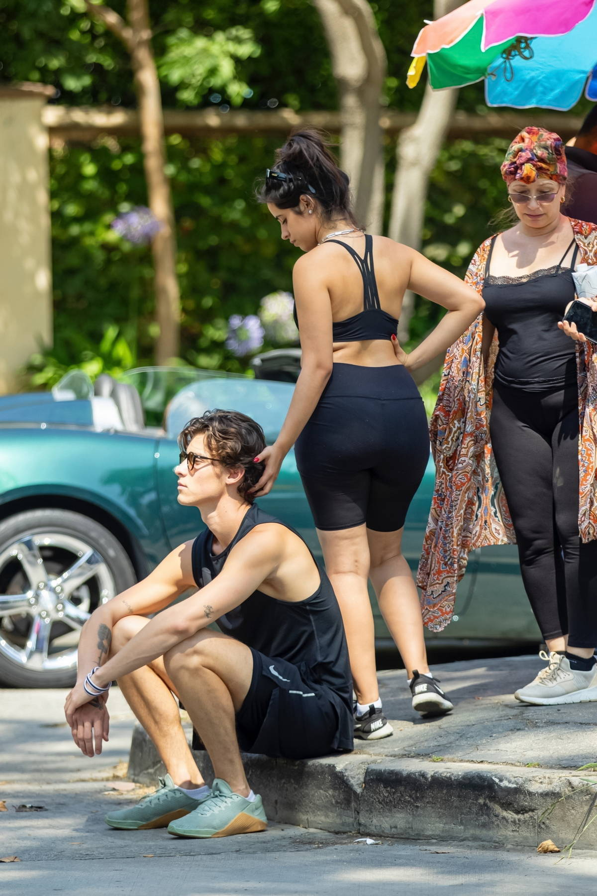 Camila Cabello and Shawn Mendes pack on the PDA while enjoying a stroll with her mom at a Beverly Hills park, California