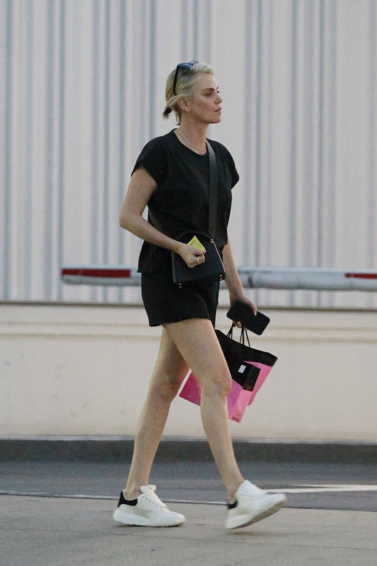 Charlize Theron wears a black tee and shorts as she leaves Mr. Chow restaurant in Beverly Hills, California