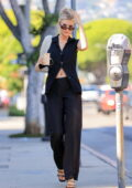 Charlotte McKinney flashes her flat abs in an all-black ensemble while out for coffee in West Hollywood, California