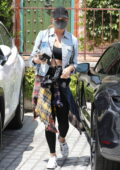 Chrissy Teigen dons a denim jacket with a sports bra and leggings while running a few errands in Los Angeles