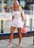 Christine McGuinness puts on a leggy display in a floral print mini dress while out running errands in Chesire, UK