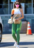 Eiza Gonzalez shows off her fit figure in a white tank top and green leggings while shopping groceries in Los Angeles