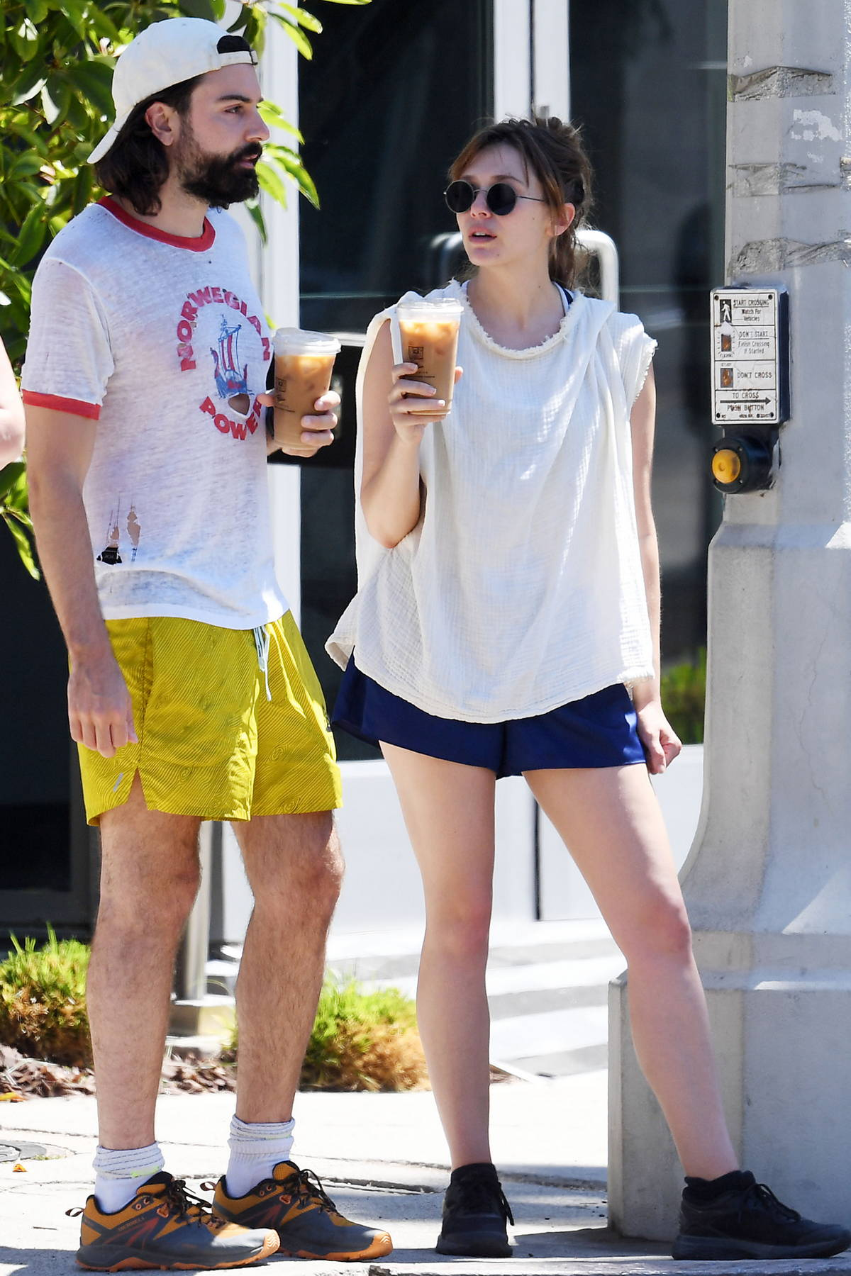 Elizabeth Olsen gets leggy in blue shorts while stepping out for iced coffee with Robbie Arnett in Los Angeles