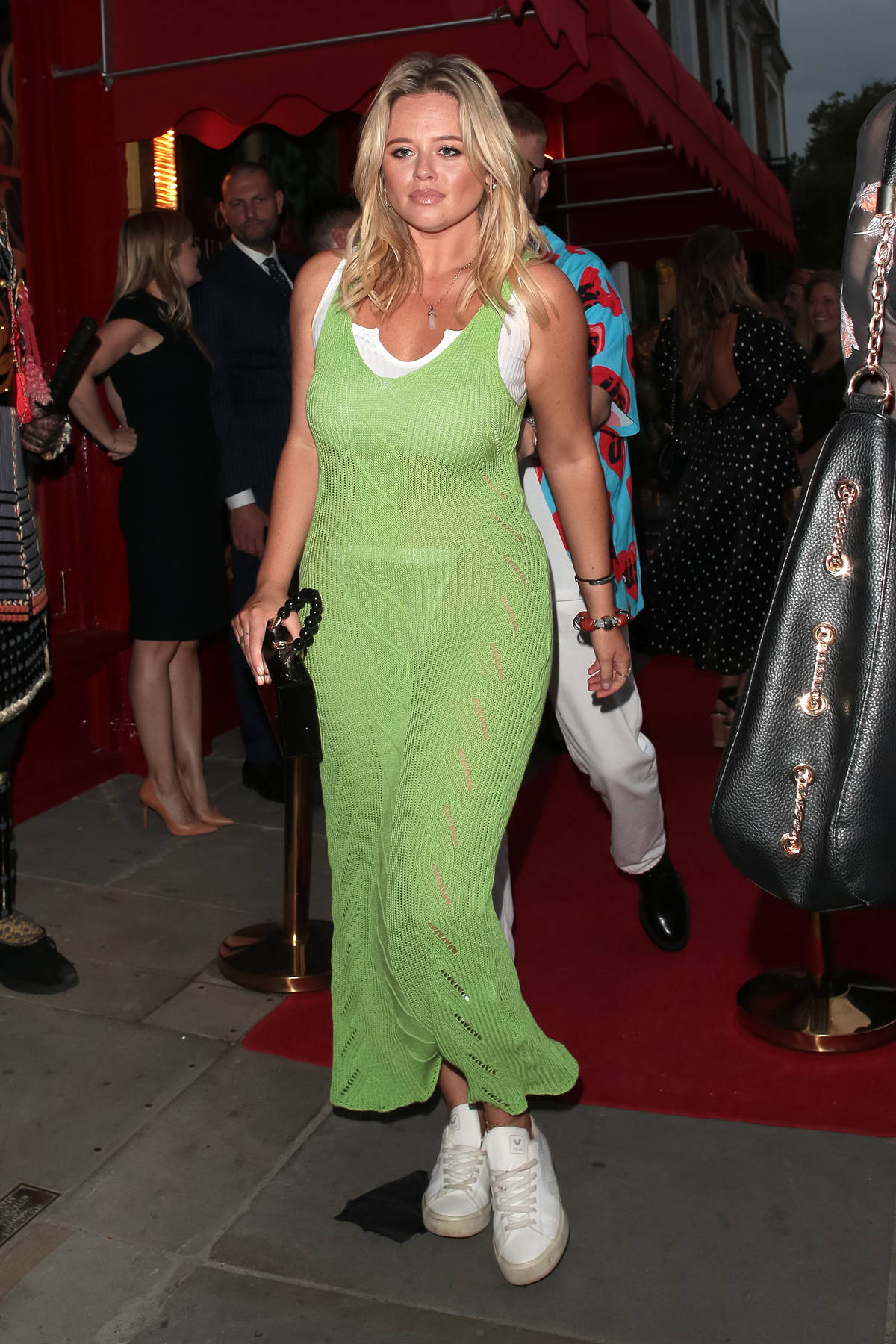 Emily Atack stuns in a sheer green dress as she leaves The Ivy Asia Restaurant Launch Party with Jude Taylor in London, UK