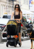Emily Ratajkowski flashes her toned abs while enjoying a stroll with her husband and son in New York City