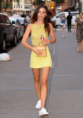 Emily Ratajkowski looks radiant in a yellow outfit as she steps out for dinner in New York City