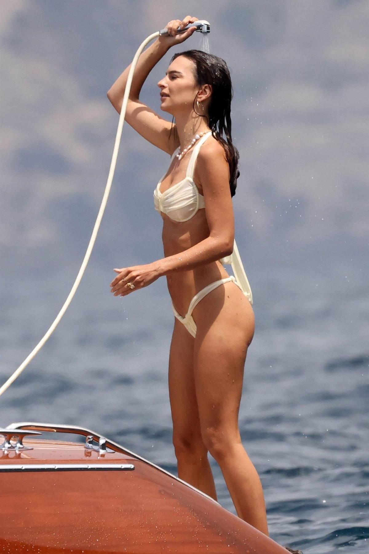 Emily Ratajkowski sizzles in a cream bikini while enjoying a day on a luxury boat her husband on the Amalfi Coast, Italy