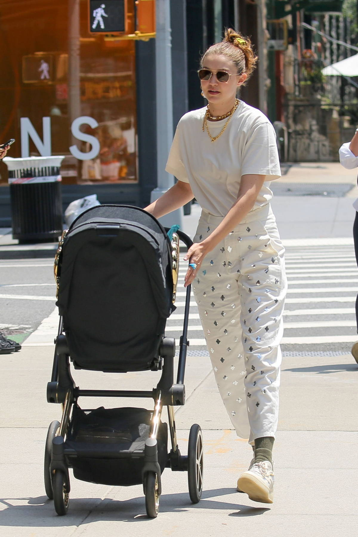 Gigi Hadid keeps it casual yet trendy as she steps out for stroll with her baby daughter in New York City