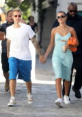 Hailey and Justin Bieber hold hands as they enjoy a romantic stroll during their vacation in Mykonos, Greece