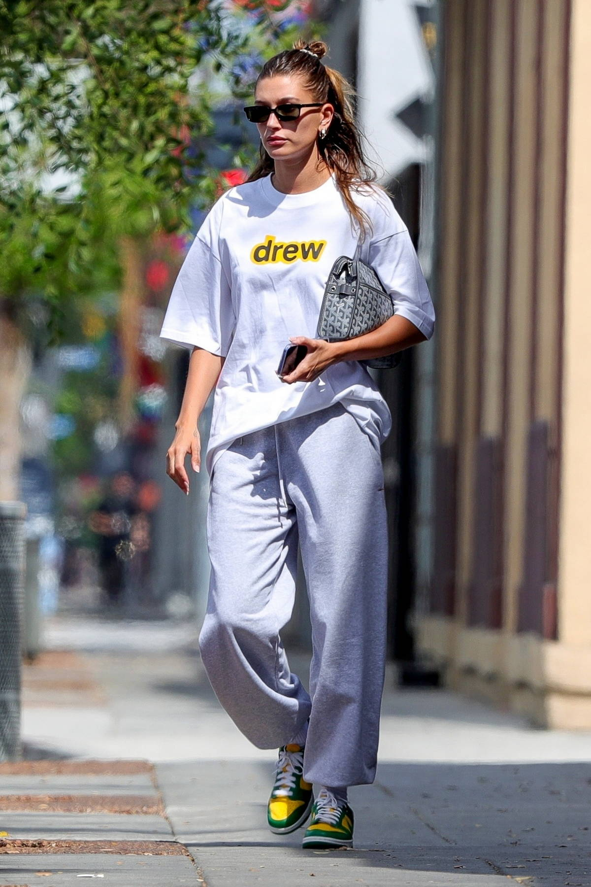 Hailey Bieber dons comfy grey sweats and colored Nike sneakers while leaving Voda Spa in West Hollywood, California