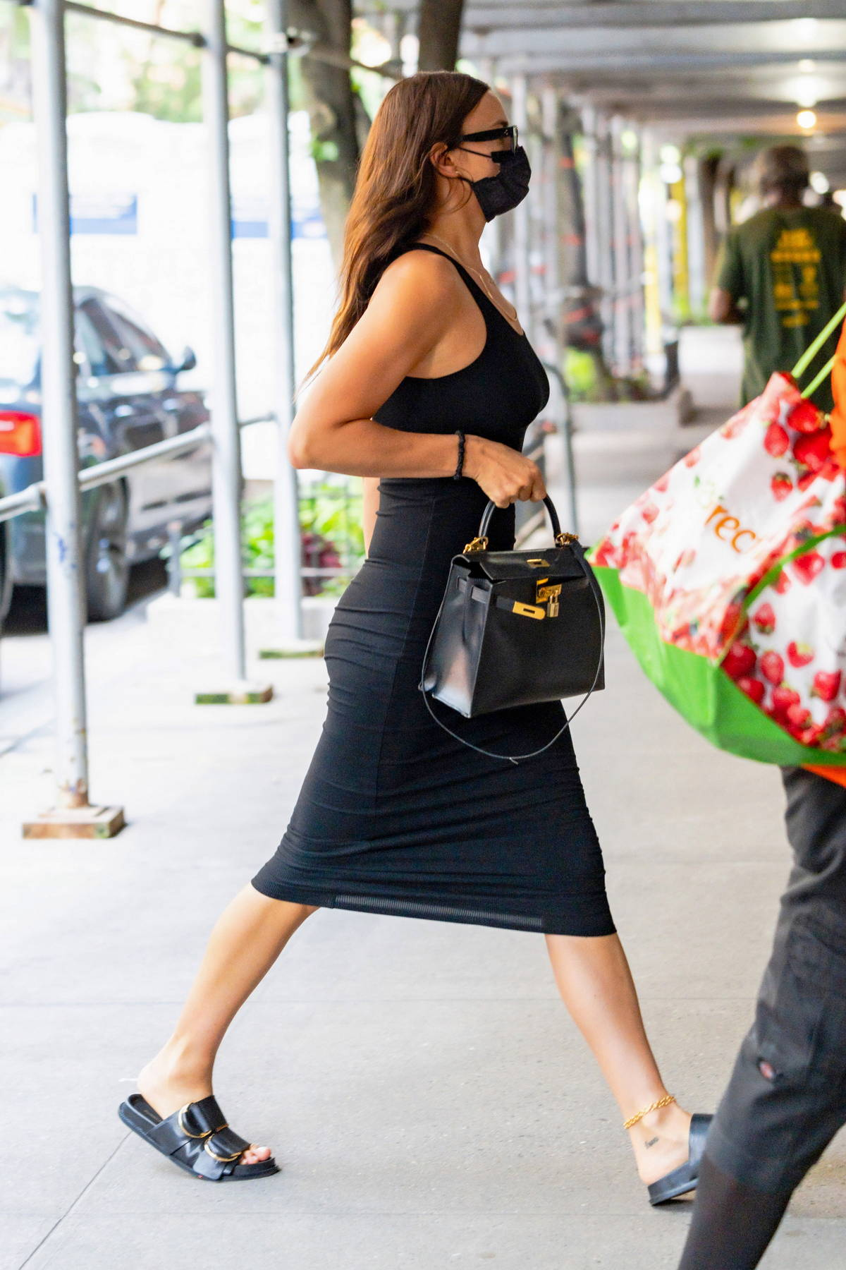 Irina Shayk looks great in a form-fitting black dress while out running errands in New York City