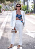 Izabel Goulart rocks a white suit with a blue top while on the Croisette during the 74th Cannes Film Festival in Cannes, France