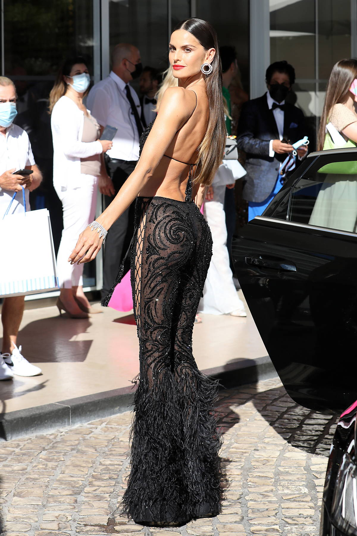 Izabel Goulart stuns in a black lace outfit as she leaves the Martinez Hotel during the 74th Cannes Film Festival in Cannes, France