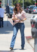 Jennifer Garner wears a pink shirt and blue jeans as she heads to her office in Brentwood, California