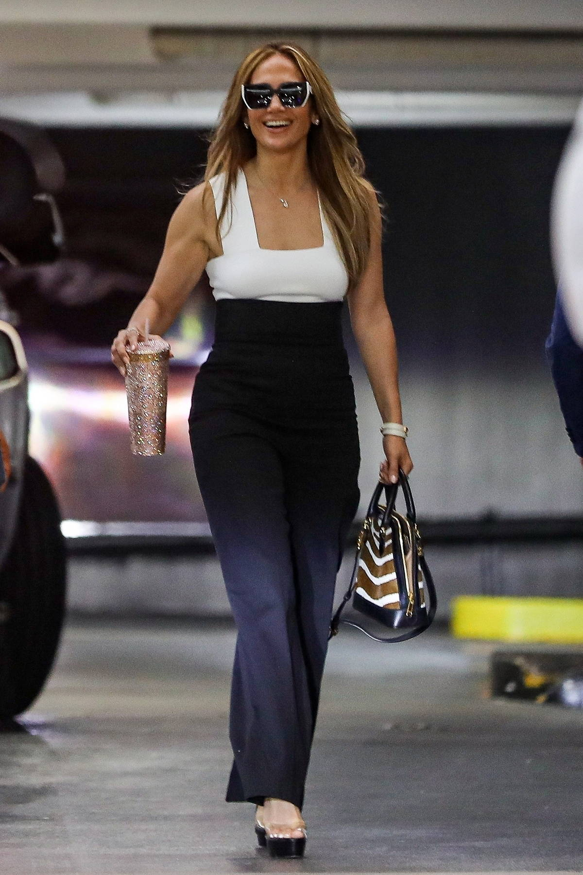 Jennifer Lopez is all smiles as she heads to a business meeting in West Hollywood, California