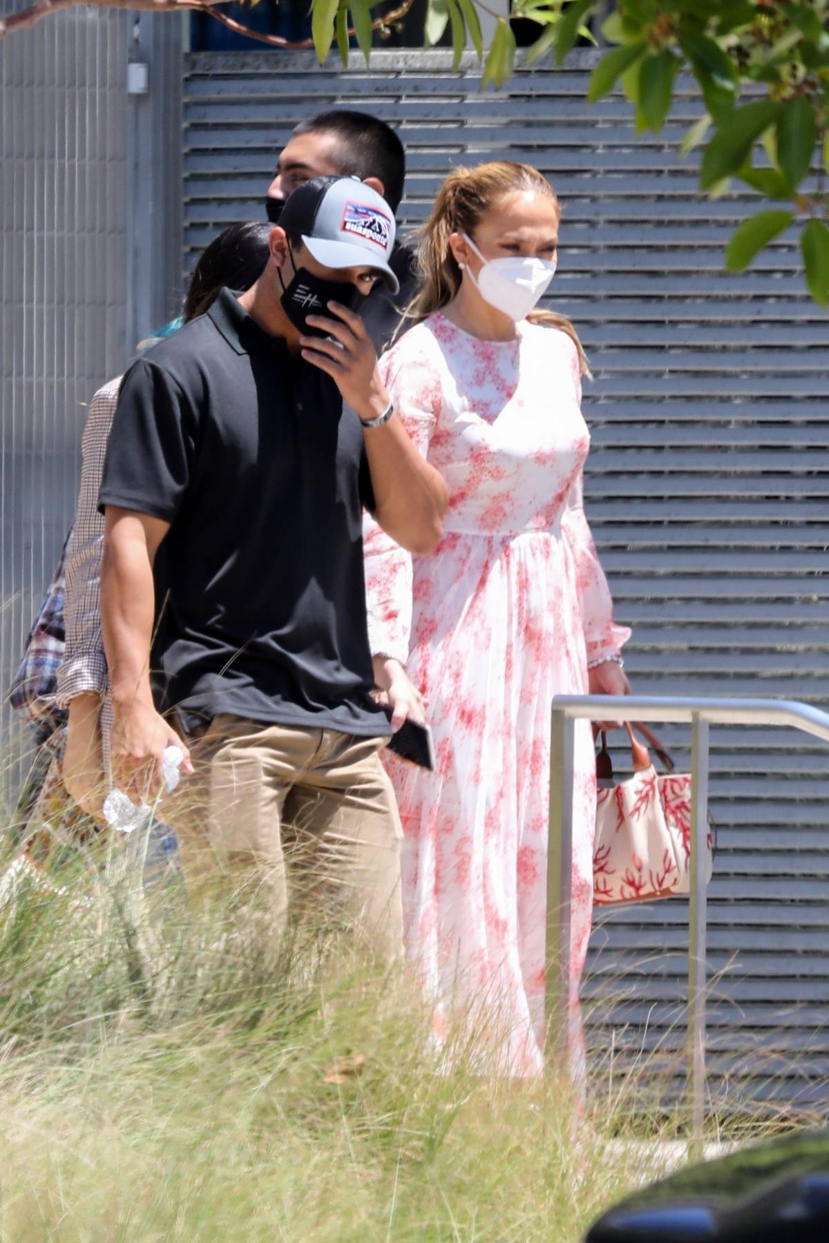 Jennifer Lopez looks pretty in a pink dress as she steps out with her kids in Los Angeles