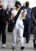 Kaley Cuoco seen carrying her pooch while arriving at the JFK Airport in New York City