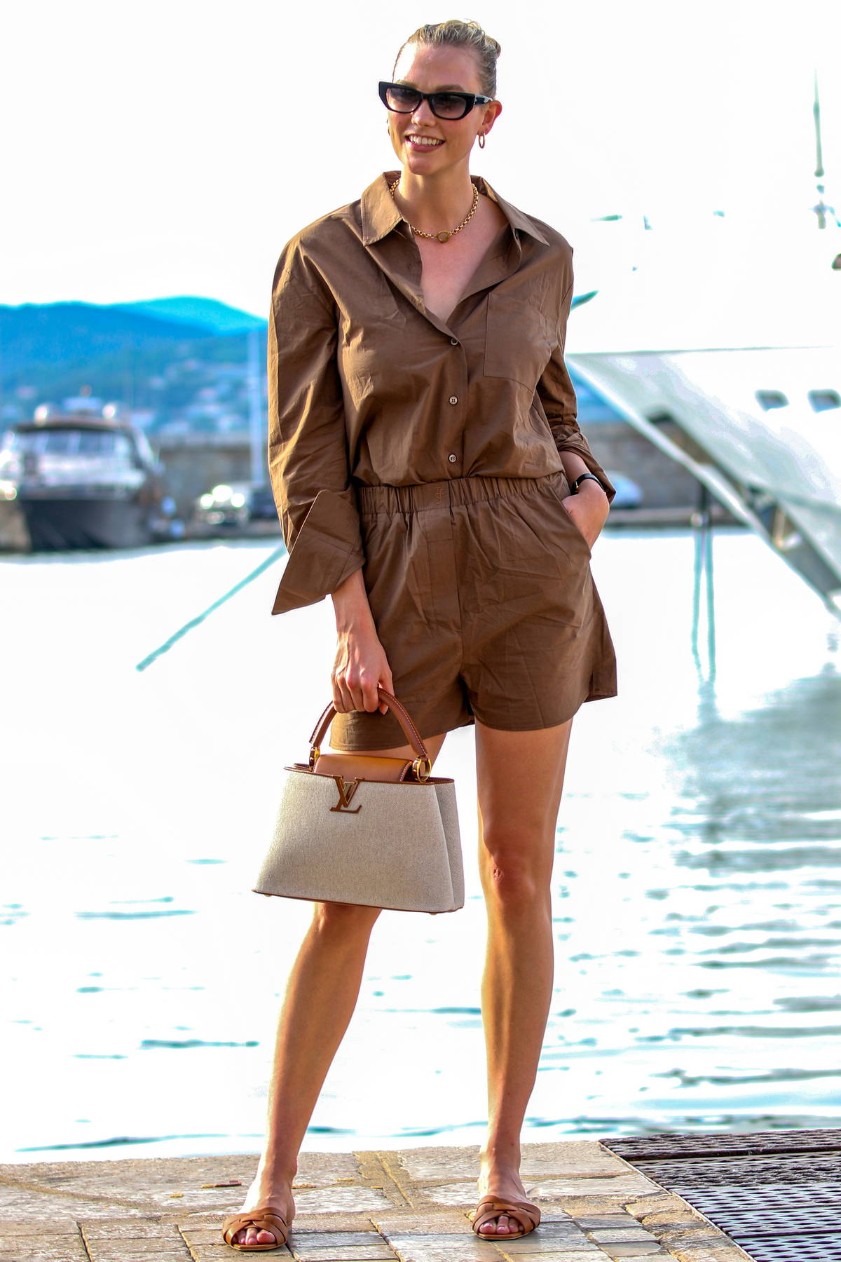 Karlie Kloss keeps it casual chic as she steps out in dark brown outfit in Saint-Tropez, France