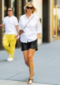 Karolina Kurkova looks stylish in a white shirt and black leather shorts while out in New York City
