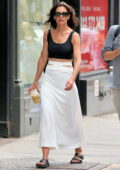 Katie Holmes looks great in a black tank top and white skirt while out running errands in New York City