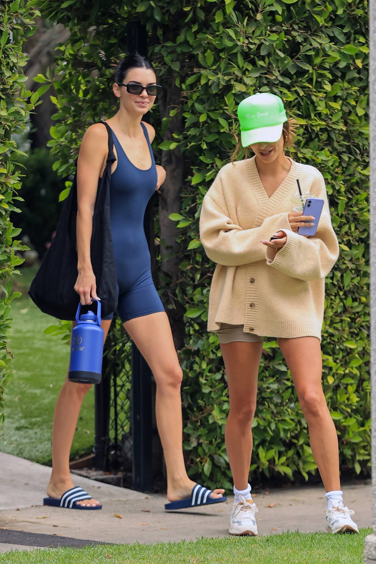 Kendall Jenner and Hailey Bieber are all smiles as they leave after a Pilates class in West Hollywood, California