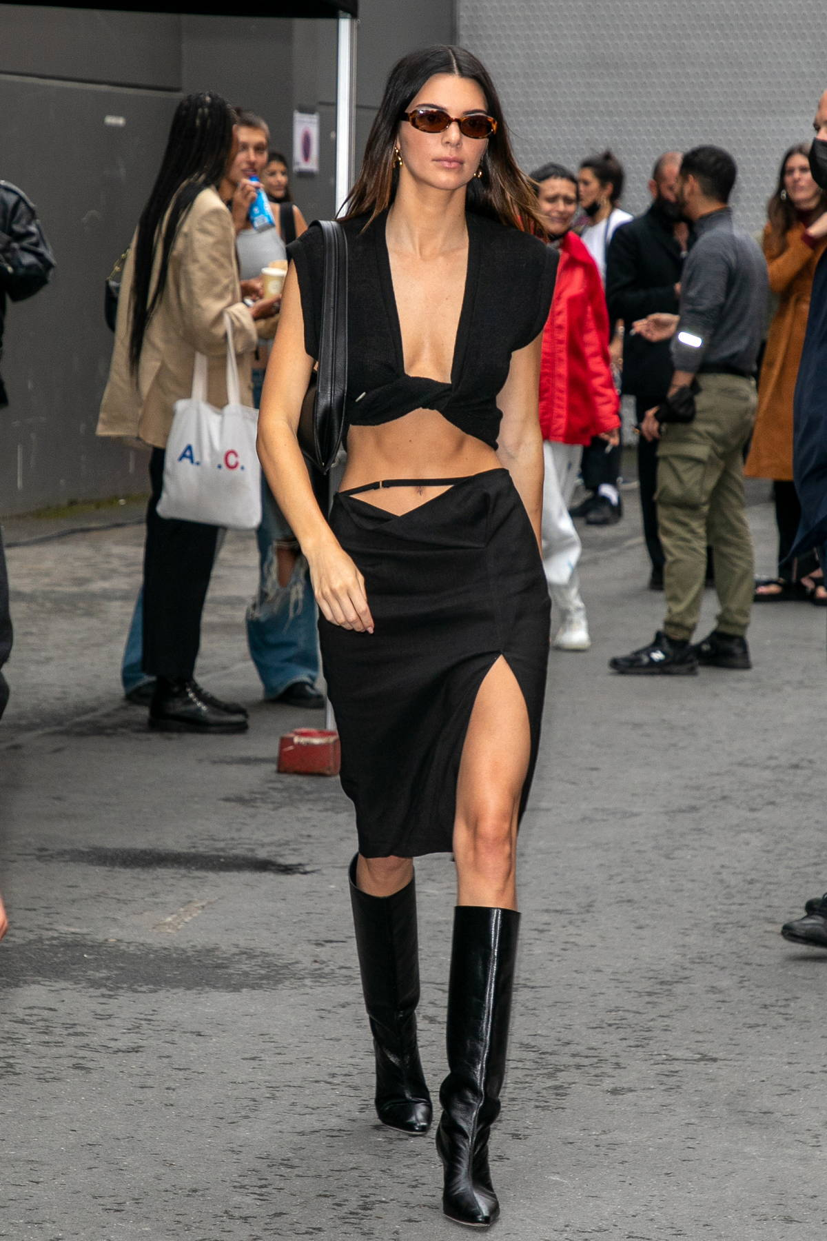 Kendall Jenner shows off her perfectly toned abs while leaving the Jacquemus show in Paris, France
