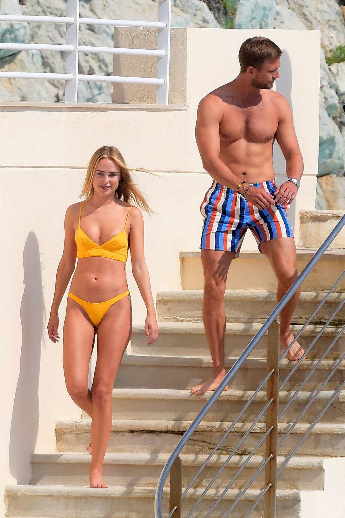 Kimberley Garner shows off her incredible physique in a yellow bikini while enjoying the sun in Antibes, France