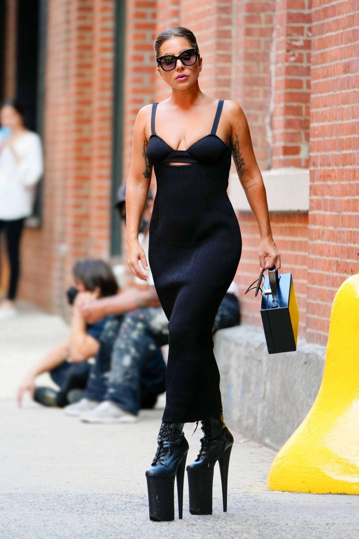 Lady Gaga rocks a pair of super high heels with a black dress as she leaves a studio in New York City