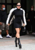 Lady Gaga stuns in black dress with white feather fringe and black platform heels leaving Milk Studios in New York City
