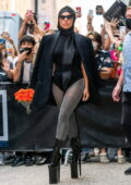 Lady Gaga wears a leotard with matching turban, blazer, and high platform heels as she leaves Highline Stages in New York City