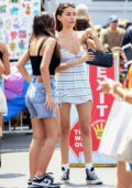 Madison Beer looks cute in a striped mini dress while out shopping with friends at the flea market in Los Angeles
