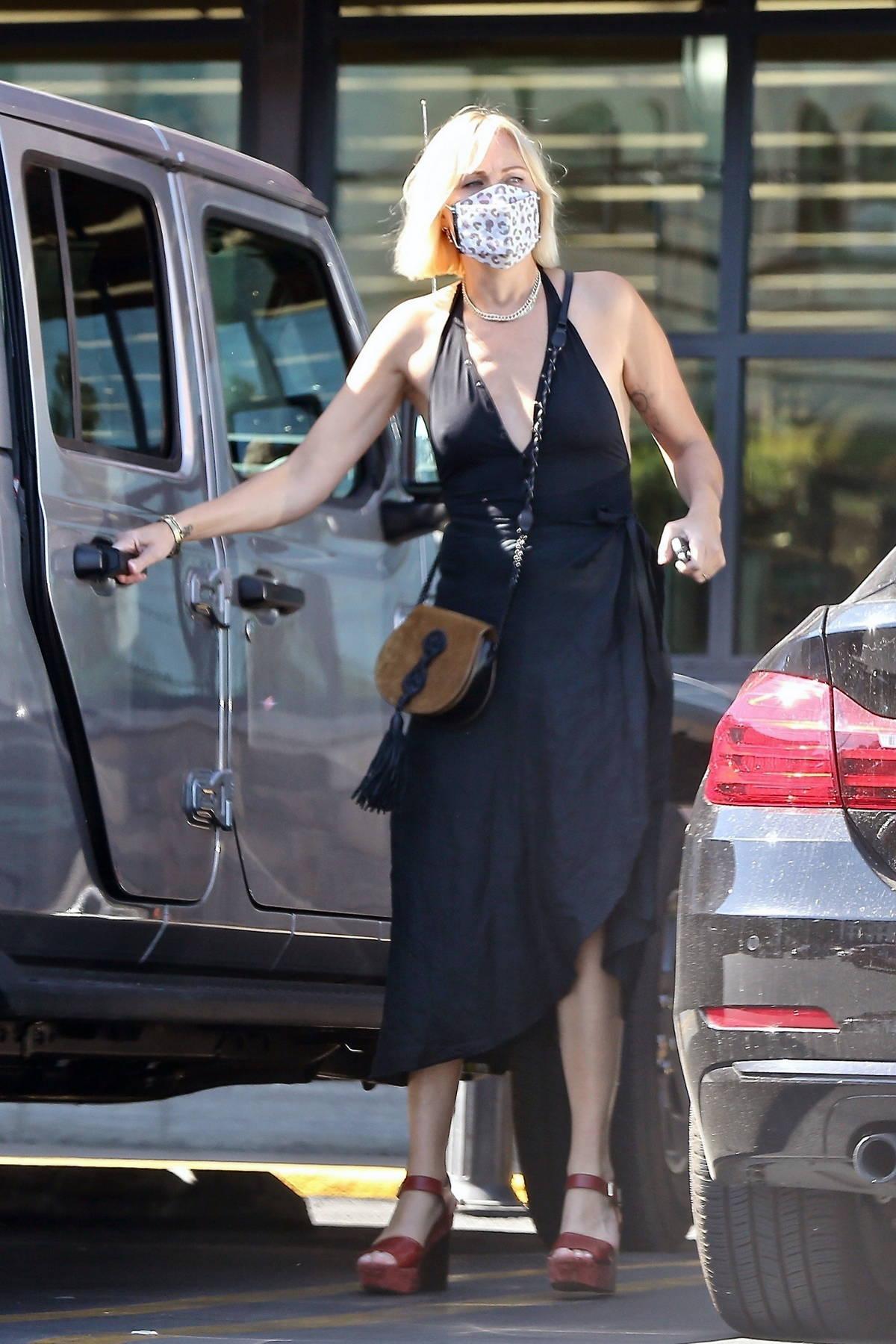 Malin Akerman looks great in a black dress as she goes grocery shopping in Los Feliz, California